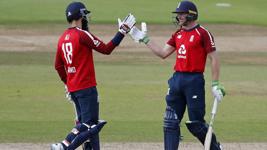 Moeen Ali gives Jos Buttler a handshake after his six sealed victory