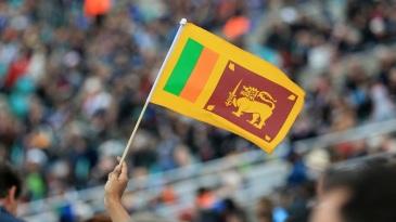 A fan holds up a Sri Lanka flag