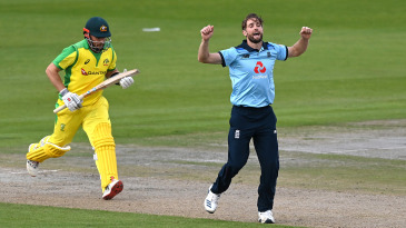 Chris Woakes celebrates taking the wicket of Aaron Finch