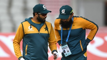 Azhar Ali and Misbah-ul-Haq catch up during a training session