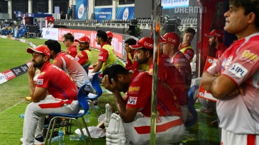 The Kings XI Punjab players wear dejected faces in the dugout