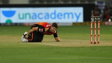 Mitchell Marsh clutches his ankle after taking a tumble