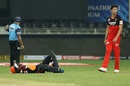 Rashid Khan is down after a mid-pitch collision with Abhishek Sharma. Bowler Shivam Dube looks on, Sunrisers Hyderabad v Royal Challengers Bangalore, IPL 2020, Dubai, September 21, 2020