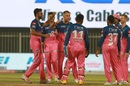 The Rajasthan Royals players gather together to celebrate a wicket, Rajasthan Royals v Chennai Super Kings, IPL 2020, Sharjah, September 22, 2020