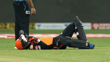 Rashid Khan is floored after a mid-pitch collision with batting partner Abhishek Sharma