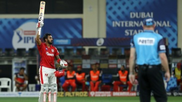 KL Rahul raises his bat after getting to his century