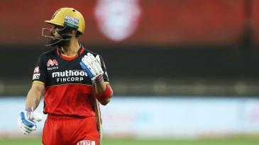 Virat Kohli walks off the field after being dismissed