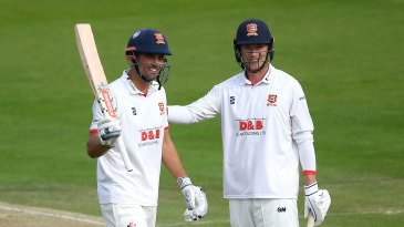Alastair Cook is congratulated by Tom Westley on his century