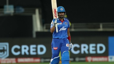 Prithvi Shaw raises his bat after getting to fifty