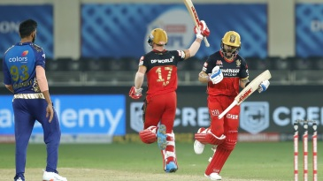 Virat Kohli and AB de Villiers celebrate the win as Jasprit Bumrah looks on
