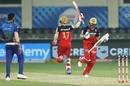 Virat Kohli and AB de Villiers celebrate the win as Jasprit Bumrah looks on, Mumbai Indians vs Royal Challengers Bangalore, IPL 2020, Dubai, September 29, 2020