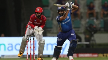 Rohit Sharma drives down the ground