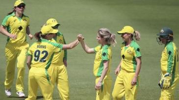 Nicola Carey celebrates the dismissal of Katie Perkins