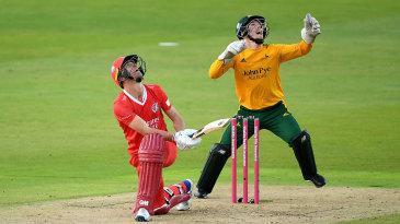 Dane Vilas top-edges a sweep as Tom Moores looks on