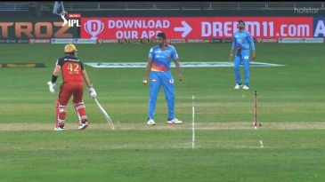 R Ashwin looks at Aaron Finch after the batsman strayed out of the crease at the non-striker's end