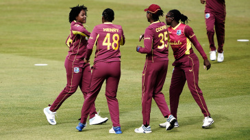 Sheneta Grimmond (extreme left) celebrates a wicket with her team-mates