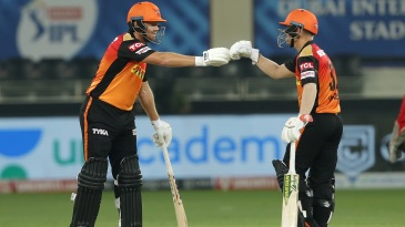 David Warner punches gloves with Jonny Bairstow