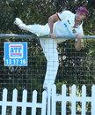Mark Steketee clambers the fence to retrieve the ball, Queensland v Tasmania, Sheffield Shield, Park 25, Adelaide, October 10, 20202