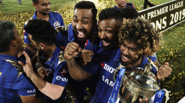 Lasith Malinga holds the IPL trophy and celebrates with Krunal and Hardik Pandya