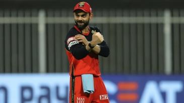 Virat Kohli sports a smile while fielding