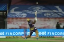 Andre Russell muscles one down the ground, Royal Challengers Bangalore vs Kolkata Knight Riders, IPL 2020, Sharjah, October 12, 2020