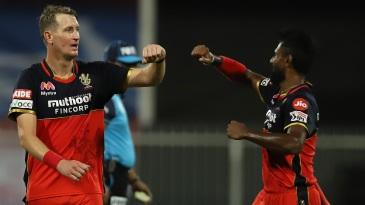 Chris Morris celebrates a wicket with Isuru Udana