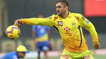 MS Dhoni warms up for the game with a spot of football