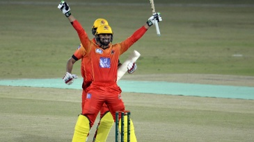 Danish Aziz celebrates after hitting a match-winning last-ball six