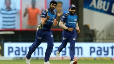 Jasprit Bumrah and Rohit Sharma are understandably pleased after sending back Andre Russell