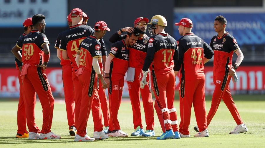 Yuzvendra Chahal surrounded by his RCB team-mates after yet another strike