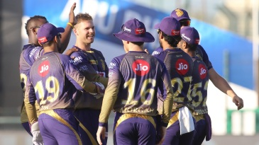 KKR players gather around Lockie Ferguson after he removed Kane Williamson with his first ball of the tournament