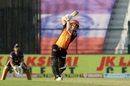 Finding his gears at No.4 - David Warner lifts one down the ground, Sunrisers Hyderabad vs Kolkata Knight Riders, IPL 2020, Abu Dhabi, October 18, 2020