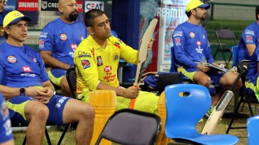MS Dhoni is pensive as he examines his blade
