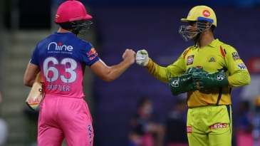 MS Dhoni and Jos Buttler bump fists after the game