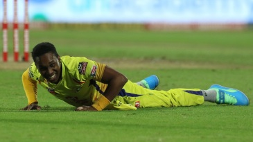 Dwayne Bravo takes a tumble during the game against Delhi Capitals in Sharjah on October 17