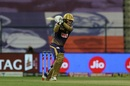 Eoin Morgan drives one pitched up to him, Kolkata Knight Riders vs Royal Challengers Bangalore, IPL 2020, Abu Dhabi, October 21, 2020