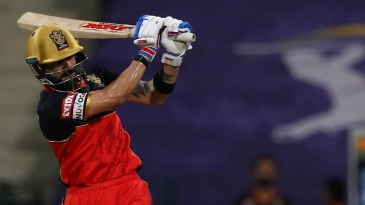 Virat Kohli swats away a short ball