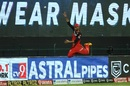 Gurkeerat Singh Mann goes flying in an attempt to stop a six, Kolkata Knight Riders vs Royal Challengers Bangalore, IPL 2020, Abu Dhabi, October 21, 2020