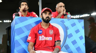 A tense KL Rahul looks on from the dressing room