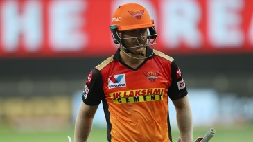 A disappointed David Warner walks off