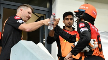 David Warner bumps fists with Wriddhiman Saha after the latter's innings ended just short of a century