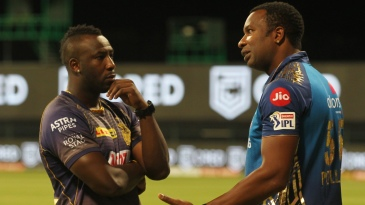 Andre Russell and Kieron Pollard have a chat after the game