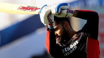 Virat Kohli practises before the start of the match
