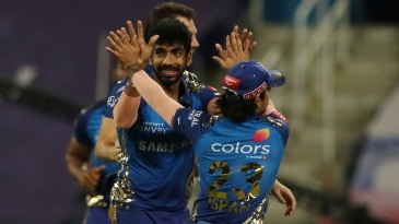 Jasprit Bumrah celebrates after taking a wicket