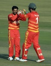 Sikandar Raza and Brendan Taylor celebrate a wicket, Pakistan vs Zimbabwe, 1st ODI, Rawalpindi, October 30, 2020