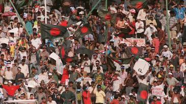 Bangladeshi cricket fans celebrate with national flags