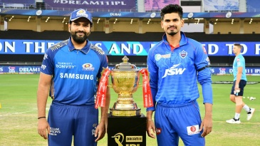 Rohit Sharma and Shreyas Iyer pose with the trophy