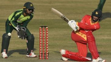 Sean Williams sweeps as Pakistan wicketkeeper Mohammad Rizwan looks on