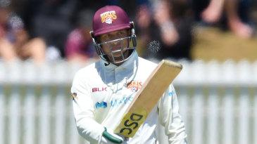 Usman Khawaja set up Queensland with a century