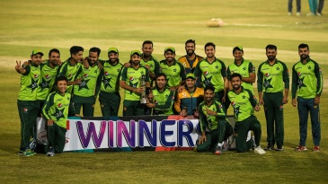 The Pakistan players pose with the trophy